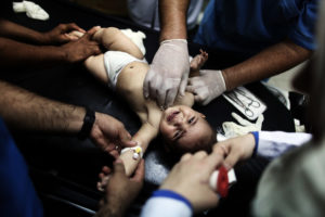 Palestinian children, wounded in an Israeli strike on a compound housing a U.N. school in Beit Hanoun