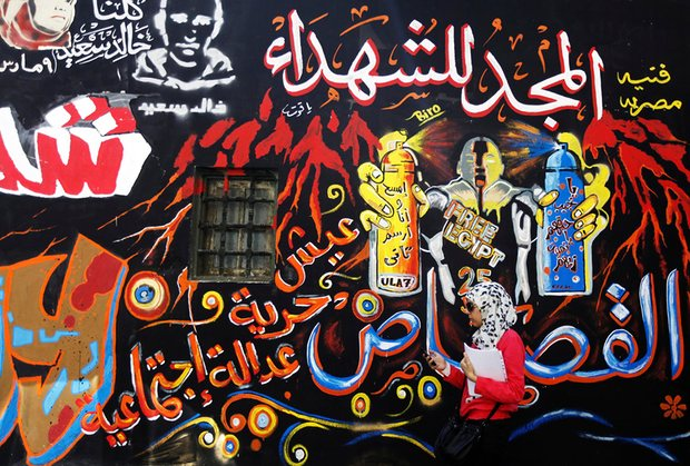 The graffiti on the walls of Mohamed Mahmoud street are a visual reminder of the fighting between protesters and security forces. Photograph: Amr Dalsh/Reuters